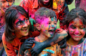 Children play Holi with fun and frolic.