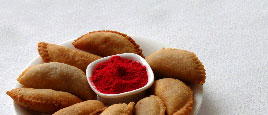Gujia and many more sweets are prepared as a food on Holi.